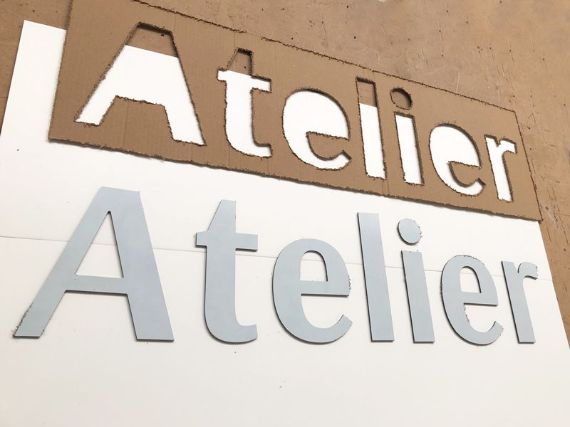 Lettres découpées alu composite du mot Atelier pour un commerçant de Rennes
